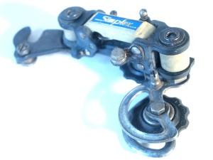 Encore un Peugeot  ancien ! Simplex-prestige-537-schaltung-derailleurs-schaltwerk-gear-back-arriere-a-7309114.jpg?u=http%3A%2F%2Fwww.velovilles.com%2Fout%2Fpictures%2Fgenerated%2Fproduct%2F1%2F300_225_90%2Fsimplex-prestige-537-schaltung-derailleurs-schaltwerk-gear-back-arriere-a-7309114