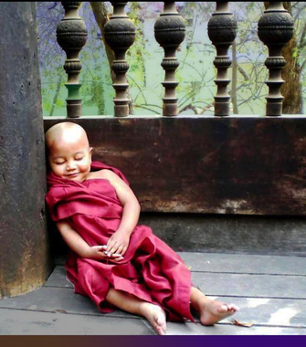 small Buddhist monk in training having a little lie down ...